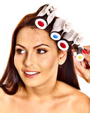 Woman wear hair curlers on head. Stock Images