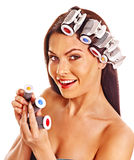 Woman wear hair curlers on head. Stock Photo