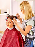 Woman wear hair curlers on head. Royalty Free Stock Images