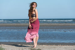 Woman wear long skirt and top, standing on the beach Royalty Free Stock Photo