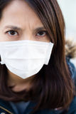Woman wear medical mask close up Stock Image
