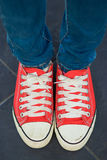 Woman wear red canvas shoes Royalty Free Stock Photo