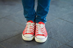 Woman wear red canvas shoes Royalty Free Stock Images