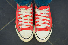 Woman wear red canvas shoes Royalty Free Stock Photos
