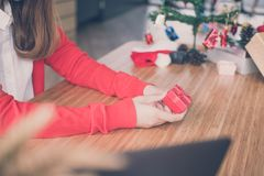 Woman wear red cardigan at home. girl with gift present box. chr. Woman wear red cardigan at home. girl hold gift present box. christmas, new year holiday. merry Stock Image