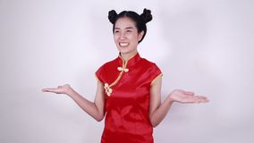 Woman wear red cheongsam with open hand palm in concept of chinese new year stock footage