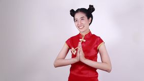 Woman wear cheongsam and pay respect in concept of happy chinese new year stock video footage