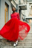 Woman Wear Red Elbow-sleeved Dress Walking on Stair stock images