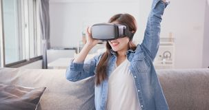 Woman wear virtual reality headset stock images
