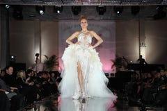 Woman wear wedding dress walks catwalk stock photo