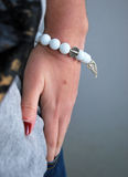 Woman wear white bracelet Royalty Free Stock Photography
