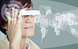 Woman with wearable device. Woman viewing contents through a head-mounted device Stock Image