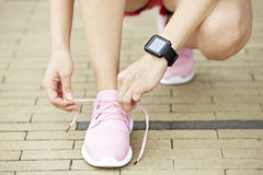 Woman with wearable fitness device stock photos