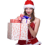 Woman weared in santa clause dress with gifts. Beautiful woman weared in santa clause dress and some gifts box Royalty Free Stock Photos