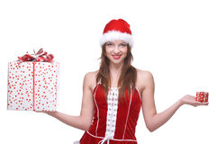 Woman weared in santa clause dress with gifts. Beautiful woman weared in santa clause dress and some gifts box Stock Photography