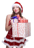 Woman weared in santa clause dress with gifts. Beautiful woman weared in santa clause dress and some gifts box Stock Images