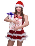 Woman weared in santa clause dress with gifts. Beautiful woman weared in santa clause dress and some gifts box Royalty Free Stock Photo