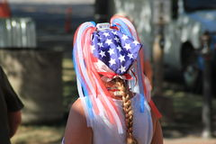 Woman wearing American flag ribbons and scarf in her hair Royalty Free Stock Photo
