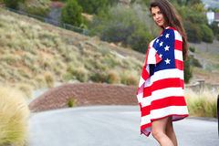 Woman wearing American Flag Stock Images