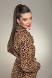 Woman wearing a animal print coat, smiling for the camera. Stock Image