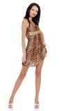 Woman wearing animal print dress holding gold bead Royalty Free Stock Photo