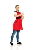 Woman wearing apron Stock Photo