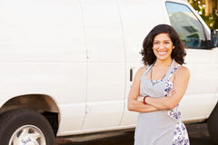 Woman Wearing Apron Standing In Front Of Van stock photo