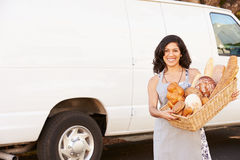 Woman Wearing Apron Standing In Front Of Van Royalty Free Stock Images
