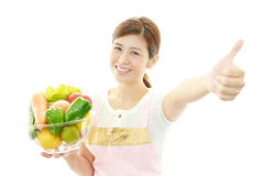 A woman wearing apron stock photography