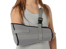 Woman wearing an arm brace Royalty Free Stock Images