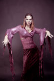 Woman  wearing  as  vampire  dancing . Halloween Royalty Free Stock Photo