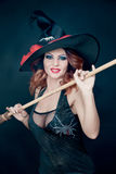 Woman  wearing  as witch  dancing . Halloween Stock Photography