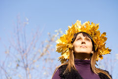 Woman wearing an autumn leaf bonnet Stock Photography