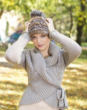 Woman wearing autumn wool sweater and hat Stock Image