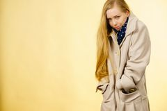 Woman wearing autumnal beige coat Stock Image