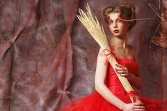 Woman wearing ball dress with bright make up Stock Photo