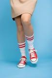 Woman wearing baseball boots Stock Image