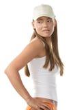 Woman wearing baseball cap. Young beauty woman wearing baseball cap biting her lip isolated on white background Stock Photo