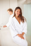 Woman wearing a bath robe Stock Photography