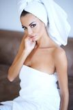 Woman Wearing Bath Towel with Hand Touching Face Stock Photos
