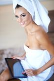 Woman Wearing Bath Towel Using Tablet Computer Royalty Free Stock Image