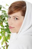 Woman wearing bathrobe Stock Image