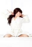 Woman wearing bathrobe Stock Photography