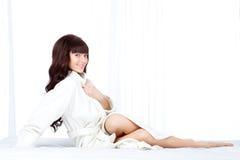 Woman wearing bathrobe Royalty Free Stock Photo