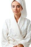 Woman wearing bathrobe Stock Image