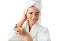 Woman wearing bathrobe with hands on head Stock Image