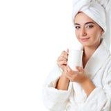 Woman wearing bathrobe holding mug Stock Images