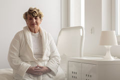 Woman wearing bathrobe in hospital Royalty Free Stock Images