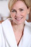 Woman wearing a bathrobe Stock Photo