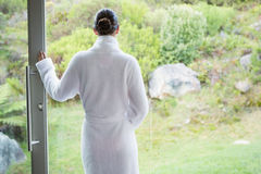 Woman wearing a bathrobe Stock Photography